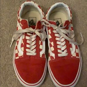 Red checkered board vans.